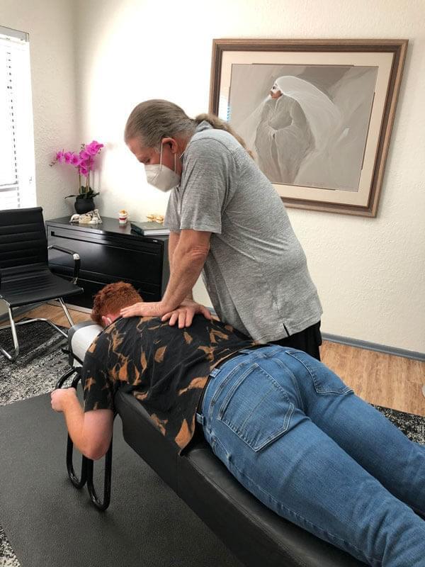 Chiropractor in Austin TX doing an adjustment